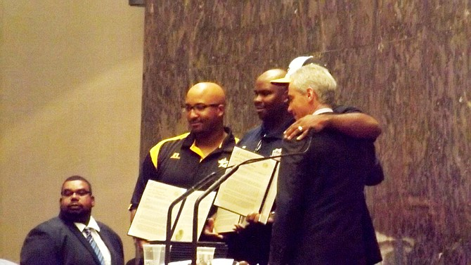 Chicago Mayor Rahm Emanuel poses for pictures with the coaches from the Jackie Robinson West All Stars during last week's Chicago City Council Meeting where the team was honored as Little League Baseball's 2014 World Series U.S. Champions.