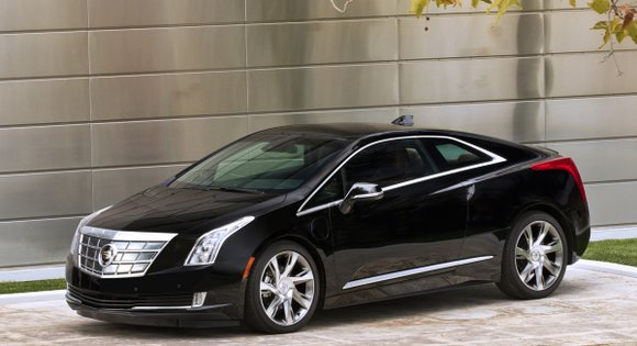 As we started writing this review there was a 2014 Cadillac ELR 2+2 coupe sitting in the driveway connected to ...