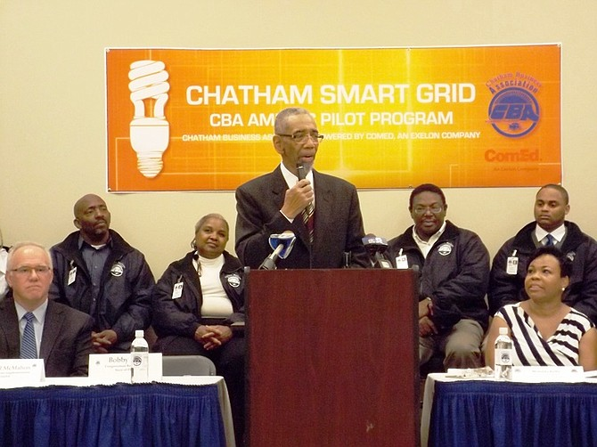 Michael McMahon, vice president of smart grid technology for ComEd, U.S. Cong. Bobby Rush (Dist.-1) and Melinda Kelly, Exec. Dir., Chatham Business Association. Back row seated, Dwain Geoghegan, Madeline Morgan, George Sims, Clifford Borner, II, participants in Chatham Business Association/ComEd, pilot, smart grid outreach, pilot training/employment program.