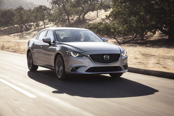 It is near impossible not to like a Mazda, in this case the automaker's flagship sedan, the Mazda6. Swept lines ...