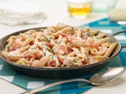 SERVINGS: 4-6 Ingredients 1 pound penne pasta 1/4 cup olive oil 1 pound medium shrimp, peeled, and deveined 4 cloves ...