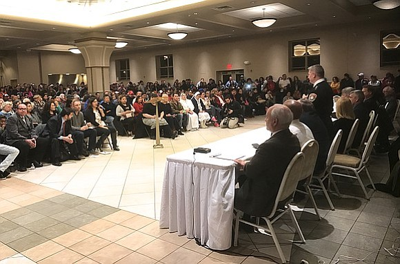 A few hundred people piled into the Mt. Carmel Church in Joliet for a special meeting of the Joliet City ...