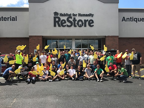 Amazon volunteers played a major part in helping to unload donated products for a ReStore tent sale, where proceeds are ...
