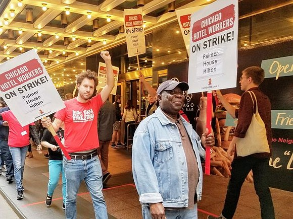 Thetimesweekly.com A striking Chicago hotel worker, Kenneth Williams, fought back tears Saturday as applause and shouts of support washed over ...