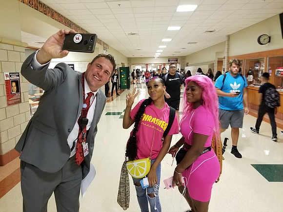 "Bolingbrook HS officially begins each school day with a greeting from Principal Dr. Jason Pascavage ""live"" from one of the ..."