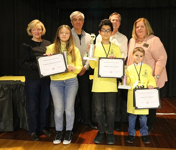 After 14 rounds of spelling, Pershing Elementary fifth-grade student Isabella Hebrard-Flores took home the first place trophy at the Joliet ...