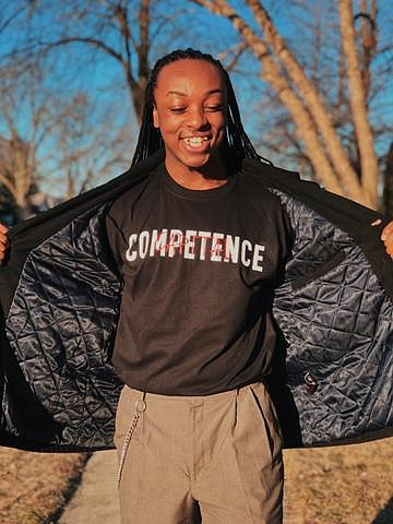"""Joliet West High School senior Aaron Travis has started his own business, """"Competence Capital,"""" a clothing company with an empowering ..."""