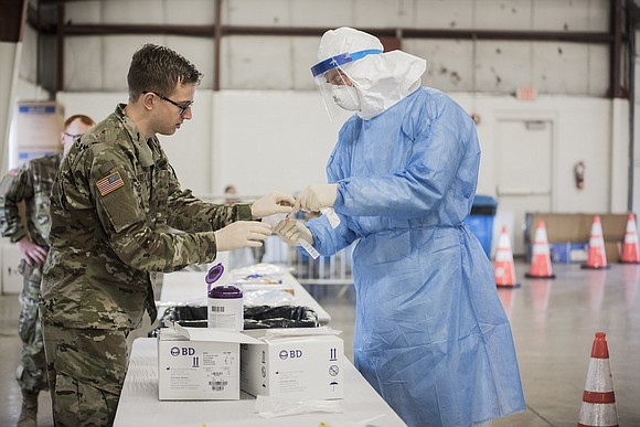The Illinois National Guard on Wednesday set up a medical facility at Stateville Correctional Center in Crest Hill to treat ...