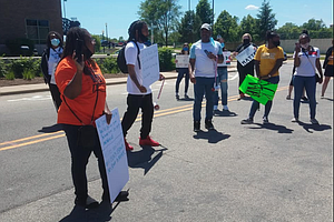 A rally was held in downtown Joliet on Sunday in response to the death of George Floyd after a Minneapolis Police officer kneeled on his neck for approximately eight minutes.