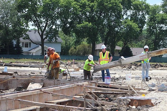Construction crews pour concrete into the gym floor of Wallin Oaks Elementary School on Wednesday, July 1. The new school ...