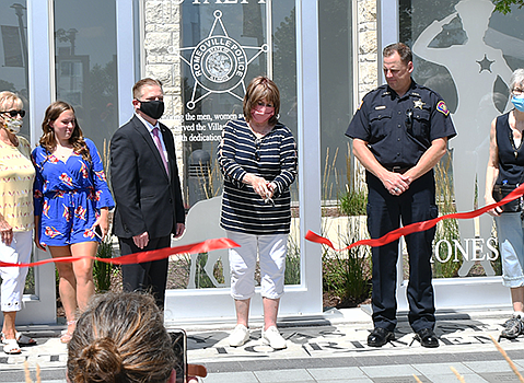 A ribbon cutting was held to celebrate the dedication of the Romeoville Police and K-9 Memorial, which sits between village ...
