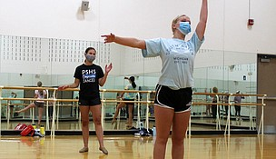 Plainfield South High School dance teams members junior Miranda Deacon (front) and senior Monica Dziecoil warm up before practicing a routine on Tuesday, August 4, 2020. The Illinois High School Association moved the 2020-2021 high school competitive dance season to spring 2021 due to the COVID-19 pandemic. The IHSA, which governs high school competitive sports, rescheduled several fall sports including football, soccer and volleyball to the spring.