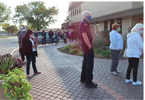 Hundreds of people turned out to cast their ballots on the first day of early voting in Will County last ...