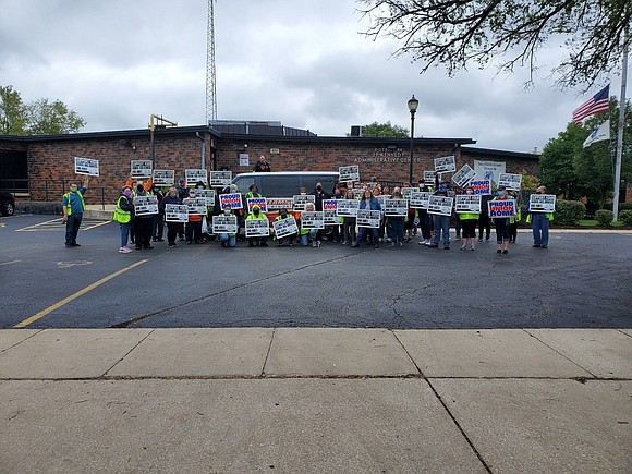 Nearly 60 school bus drivers and monitors protested with signs in front of the Joliet Public Schools District 86 administration ...