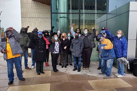 A Will County board member along with local activists stood in front of the new Courthouse in Joliet this week ...