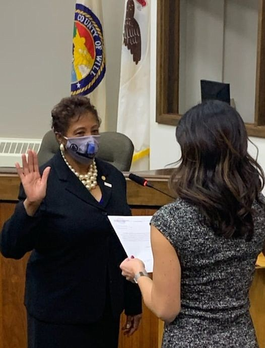 Denise Winfrey is sworn in on December 7, for another term as District 8 Commissioner.