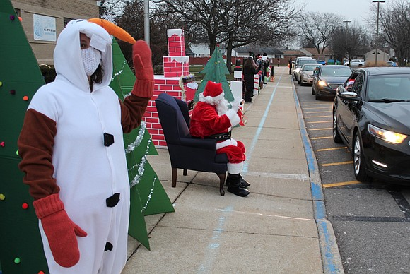 Santa visited Troy 30-C schools this month, including Troy Heritage Trail Elementary School, where families drove by to say hi ...
