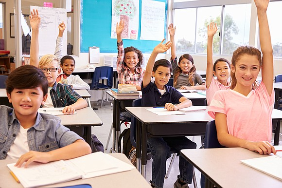 District 202 third graders in the Bilingual Summer School Program practice reading aloud the story, El planeta Tierra se presenta ...