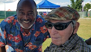 Dwight Casimere (l) with George Wein on board the famous 'Weinermobile' at the 2019 Newport Jazz Festival