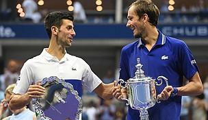 2021 US Open Men's Singles title winner Daniil Medvedev (r) and Novak Djokovic trade friendly barbs at the Trophy Presentation USTA Photo/Darren Carroll