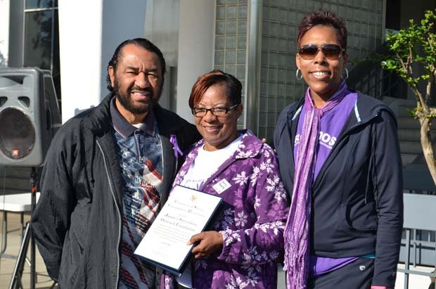 Congressman Al Green presents a proclamation in honor of the 9th Annual Sarcoidosis Walk to JSOF's founder Emma Carroll and Kelly Hodges