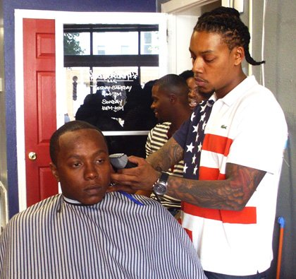 Christian Tillery, owner of Faded Heads Barber Shop on Charles Street.