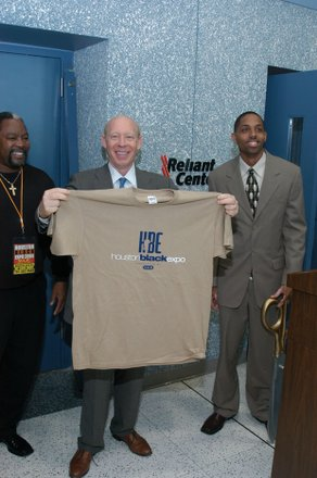 Mayor Bill White holding Black Expo T-Shirt and Jerome Love