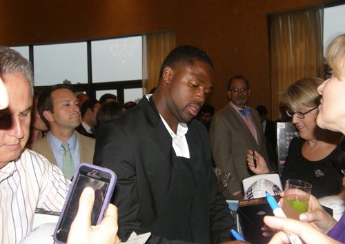 Torrey Smith signs autographs during the Celebrity Waiter Night to benefit his foundation on Thursday, June 6, 2013 in the Grand Ballroom at the Four Seasons Hotel in Baltimore.