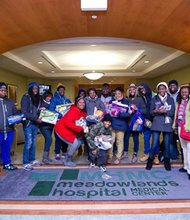 Members of the Baltimore Quantum Opportunities Program made a trip to Newtown, Connecticut to show support after the recent tragedy. On their way home, they delivered toys to the Children's Wing of the Meadowlands Hospital in Secaucus, New Jersey. (Left to right) Michael Wagstaff; Jeremy Craddock; Destiny James; Alan Taylor; Kim Green,  Quantum Mentor; Leeya Davis; Isaac Dickey; Dajah Harvey; Shanika Passmore; David Bailey; Justice Epps; Tsanonda Edwards, Quantum Director; Kim Wiggins, Quantum Academic Coordinator; and (front center) Lester Perry-Watts.