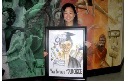"""Winner Yigi """"Yvette"""" Yu is a 2013 graduate of Meade High. She was presented a prize of $2,000 from WASP Coordinator and Hands of Hope CEO Sherry Medley and WASP Chairperson Derrick Farmer."""