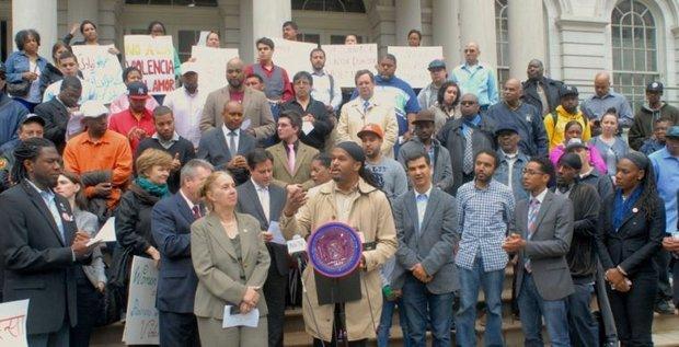Rally at City Hall last week had fathers denouncing domestic violence.