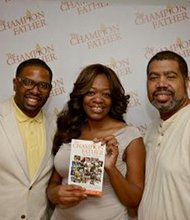 Kashaun Cooper (left) with Paul Franklin and his wife who attended the official book signing event at Phaze Lounge/restaurant in downtown Baltimore.