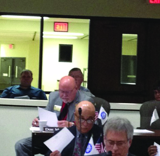 Will County board member Don Moran (D-Romeoville) reads a letter from Midwest Generation supporting the Cool County resolution.