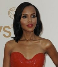 Actress Kerry Washington poses on the red carpet before attending the 63rd Annual Primetime Emmy Awards in Los Angeles, California on September 18, 2011.