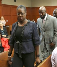 Trayvon Martin's parents, Sabrina Fulton, far left, and Tracy Martin, center, arrive in the courtroom for George Zimmerman's trial in Semimole circuit court in Sanford, Fla. Wednesday, July 10, 2013. Zimmerman has been charged with second-degree murder for the 2012 shooting death of Trayvon Martin.