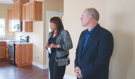 Multnomah County Commission Loretta Smith and Joe Wycowzki of Community Visions, Inc., tour a northeast Portland home that was lost to foreclosure and then rescued for new ownership thanks to a partnership between the county and the non-profit group.