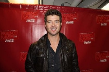 """Summer 2013 was blurry for Robin Thicke, according to what the """"Blurred Lines"""" singer told lawyers in April."""
