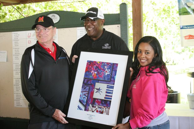 Les Merton, President of Adrian L. Merton, Inc. receiving a special gift from members of the Boys & Girls Club in appreciation for his title sponsorship of the golf tournament. (Left to right) Les Merton, president, Adrian L. Merton, Inc.; Reginald Broddie, CPO, BGCAA; and Tierra Snowden, Director of Program Operations, BGCAA.