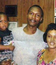 Warren Lee Hill, whose defenders say he is mentally disabled, is scheduled to die by lethal injection Tuesday for the 1990 killing of Joseph Handspike. In an undated photograph Warren Hill poses with his sister Peggy Williams and his nephew.