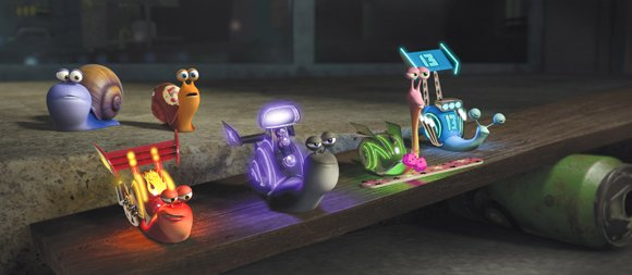 Turbo (center, back, played by Ryan Reynolds) and his brother Chet (Paul Giamatti) meet the Racing Snails (from left): Burn (Maya Rudolph), Whiplash (Samuel L. Jackson), Smoove Move (Snoop Dogg) and Skidmark (Ben Schwartz).