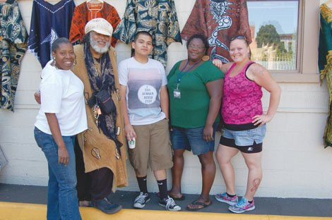 McCoy Academy's Bobby Fouther (second from left) and Carmen Hawkins (second from right), join volunteers at the non-profit's new Saturday Market venture.  McCoy, located at 3802 N.E. Martin Luther King Jr. Blvd., has served Portland as an alternative school and community resource center for 25 years.