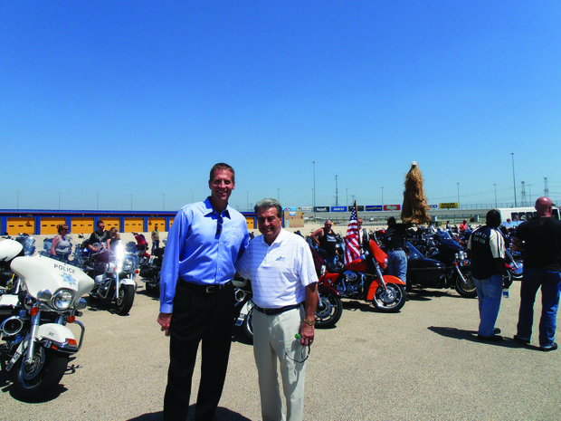 Chicagoland Speedway President Scott Paddock (left) and Joliet Mayor Tom Giarrante were on hand at Friday's tourism event at the speedway.