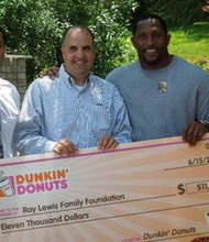"Dunkin' Donuts raised $11,000 from the Ray Lewis ""in motion"" insulated coffee mug promotion where a portion of the sales benefitted the Ray Lewis Family Foundation. (Left to right) Franchisee Parag Patel; Bob Hodes, Dunkin' Donuts, Director of Operations; Ray Lewis; and Colleen Krygiel, Dunkin' Donuts, Field Marketing Manager.      Courtesy Photo"