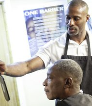 Rob Cradle cuts a client's hair at the barbershop located at the Light House transitional shelter in Annapolis, Maryland. Cradle established Rob's Barbershop Community Foundation in 2001 and began providing grooming services for the homeless and children in need throughout Baltimore.