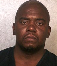 Ernest Wallace turned himself in Friday in Miramar, Florida, nearly 1,500 miles south of where Odin Lloyd was found dead, and one day after North Attleborough Police issued a 'wanted' poster in connection with Aaron Hernandez investigation.