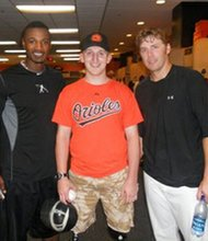 Life-long Baltimore Orioles fan Rob Jones (center) had an opportunity to meet some of baseball's top players at the All Star game in New York recently. Jones poses here with Adam Jones (left) and former Orioles infielder Mark Reynolds.
