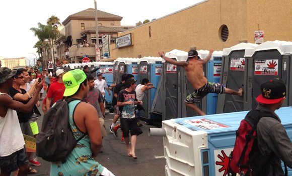 HUNTINGTON BEACH, Calif. — First, police say, came a fight in a crowd at the end of a multi-day surfing ...