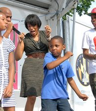 Mayor Stephanie Rawlings-Blake with Frank Johnson and Mr. Baltimore along with children dancing at the Youth Summer Block Party.