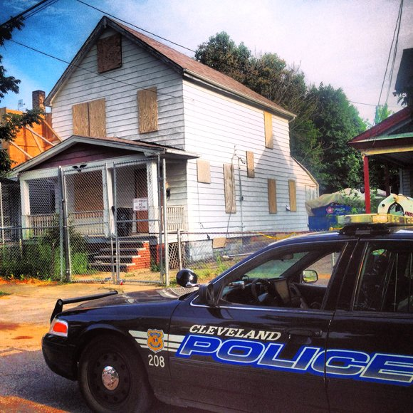 Ariel Castro's boarded up house before it was demolished, Wednesday, August 7, 2013.