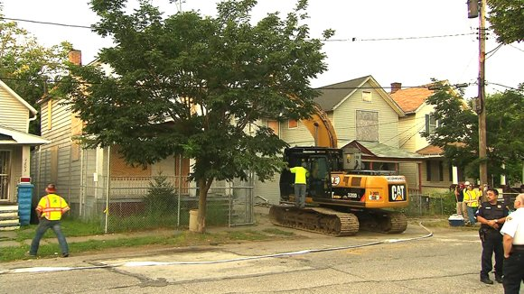 Workers began tearing down Ariel Castro's house of horrors where he held three women captive for years on Wednesday, August 7, 2013. Castro forfeited the house on Seymour Avenue as part of a plea deal with prosecutors that took the death penalty off the table in exchange for a life sentence, plus 1,000 years in prison.